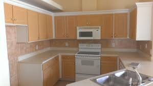 how to make kitchen cabinets look new cabinet refacing contractors in daytona beach and north florida