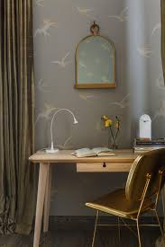 contemporary moscow apartment spells new beginnings for oksana and cage like mirror with bird wallpaper desk and console nonagon style