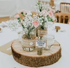 Silk Flower Wedding Centerpieces by Wedding Centerpiece Jam Jars Hessian Lace On Log Slices