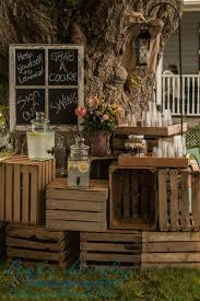 stack wooden crates and boxes to make a rustic display area for