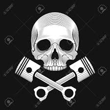 the skull and crossed car engine pistons on the black background