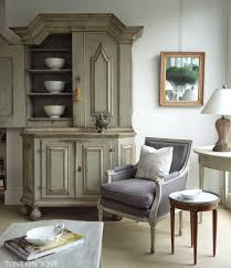 a room setting featuring a 1750s swedish baroque cupboard pair