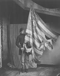 Soldier With Flag A Union Soldier Holding The Battle Scarred Flag Of The 8th