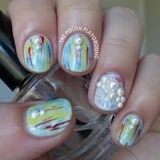 yellow and blue interlocking puzzle nails nail art by lisa n