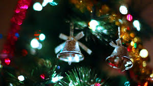 two gold bells hang on tree among of blinking