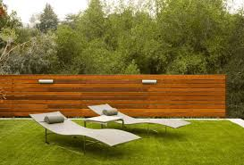 White Backyard Fence - how a horizontal wood fence can impact the landscape and décor