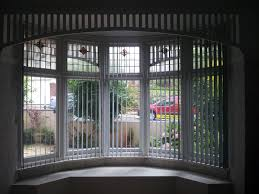 bay window decorations with nice wooden window frames and vertical