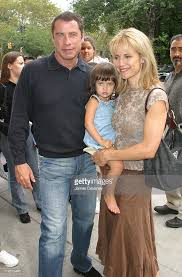 travolta and family in midtown manhattan photos and images