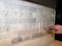 stone backsplash for kitchen how to install a marble tile backsplash hgtv