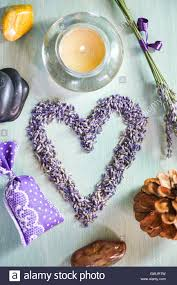 candles with heart lavender flowers on table france europe stock