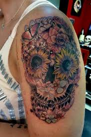 day of the dead skull with flowers by mully tattoos