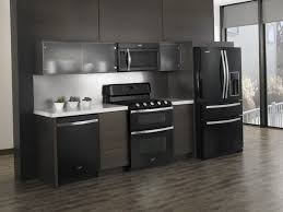 light grey kitchen cabinets with black appliances white vs black vs stainless steel appliances