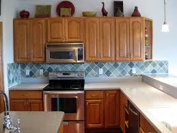 How To Faux Paint Kitchen Cabinets Remodelaholic Faux Painted Tile Backsplash