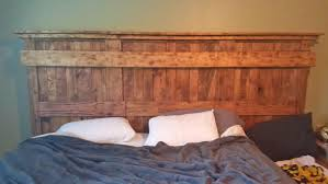 King Wood Bed Frame This Wooden King Bed Frame Leaves Space For Your Dogs