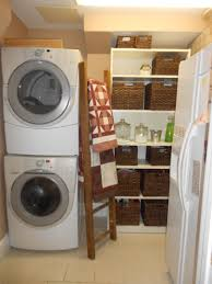 floating white wooden cabinet with pole for hanging clothes