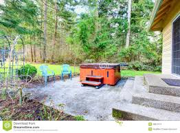 countryside concrete floor backyard with jacuzzi stock image