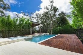 Modern Backyard Modern Backyard With Swimming Pool In Australian Mansion Stock
