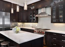 Green Tile Kitchen Backsplash kitchen design ideas dark cabinets clear glass vase flower pink