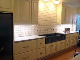 subway tile backsplash with expresso cabinets white subway tile