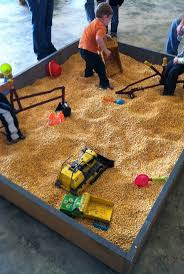tent sandbox contains sand with enough room for kids to sit