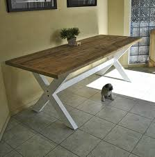 old farmhouse kitchen table with reclaimed wooden top and cross x