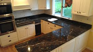 Best Design For Kitchen U Shaped Small Kitchen Design With Sleek Black Countertops And