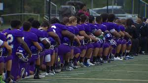 high players kneel during national anthem to protest racial