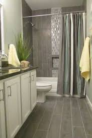 tile bathroom ideas pebble shower floor bathroom transitional with bath storage black