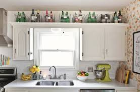 ideas for above kitchen cabinet space 7 things to do with that awkward space above the cabinets