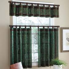 curtains design in the windows in the living room with dark brown