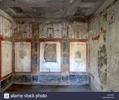 ancient roman mural at the excavated city of pompeii stock photo ancient roman mural at the excavated city of pompeii showing architecture in perspective house of