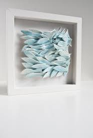 wall tile of fish sculptural ceramic artwork white