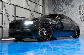 forgiato rolls royce murdered out rolls royce wraith keeps the party on the inside