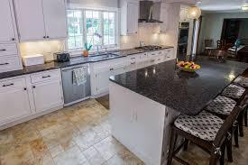 black granite countertops with white cabinets white cabinets paired with dark countertops kitchen design