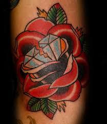 broken diamond rose flowers mens traditional arm tattoo broken