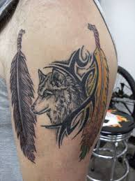 wolf feather on biceps photos pictures and sketches
