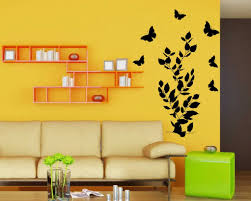 butterfly leaves wall decal on a yellow wall wall decal butterfly leaves wall decal on a yellow wall