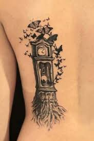 butterflies and grandfather clock tattoos on side photos