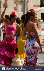 spain girls in andalucia dancing the flamenco in the street at the