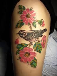 evergreen flowers tattoos on thigh