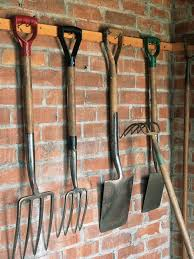 organize lawn and garden tools in the garage hgtv
