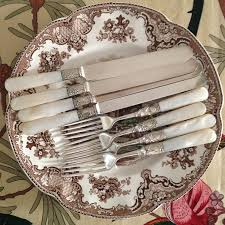 four settings of beautiful mother of pearl handled silverware with