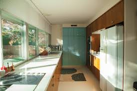 interior mid century modern kitchen design with white countertop
