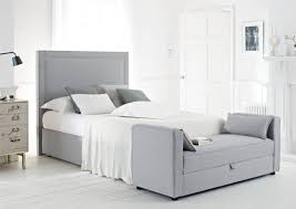 grey upholstered queen bed frame with tall headboard feat storage