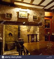 a traditional country style dining room inglenook fireplace
