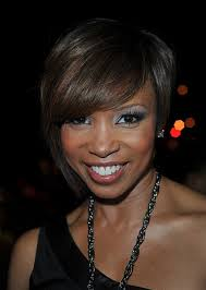 pic of black women side swept bangs and bun hairstyle short asymmetrical bob hairstyles with side swept bangs for black