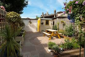 garden paving ideas patio traditional with yellow shed garden shed