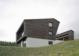 alpine chalet with a courtyard carved out of its middle
