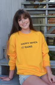 yellow sweater when it rains saying fall sweater in yellow and