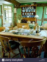 pine chairs at pine table set for breakfast in pale green country pine chairs at pine table set for breakfast in pale green country dining room with blue white china on pine dresser
